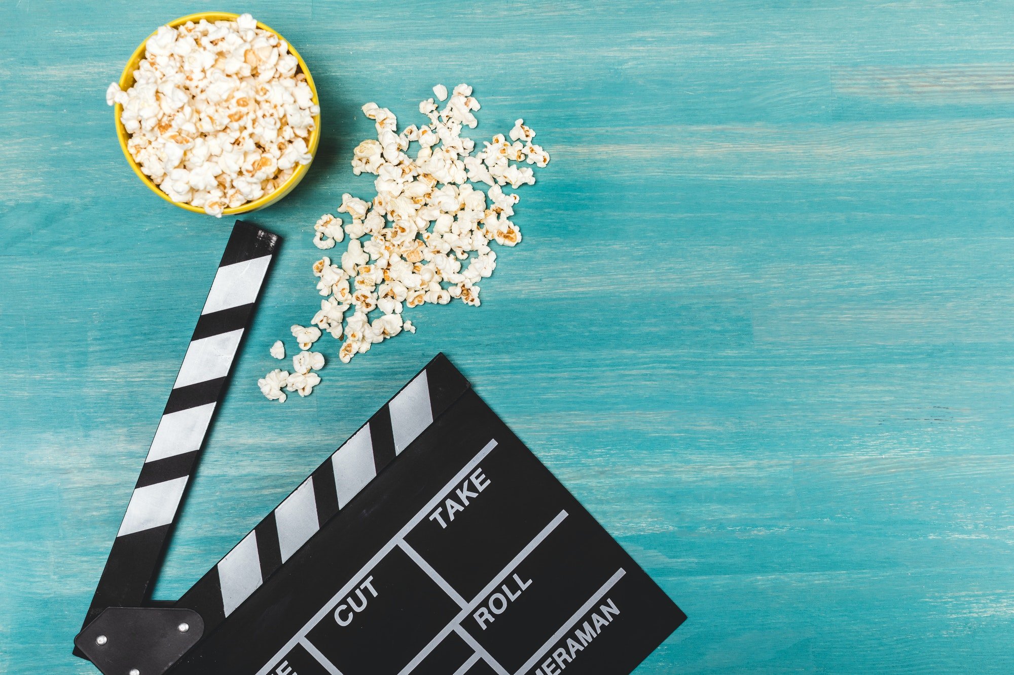 Top View Of Popcorn And Movie Clapper On Wooden Table, Movie Time Concept